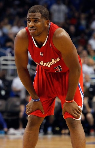 Nov 6, 2013; Orlando, FL, USA; Los Angeles Clippers point guard Chris Paul (3) against the Orlando Magic during the second half at Amway Center. Orlando Magic defeated the Los Angeles Clippers 98-90. Mandatory Credit: Kim Klement-USA TODAY Sports
