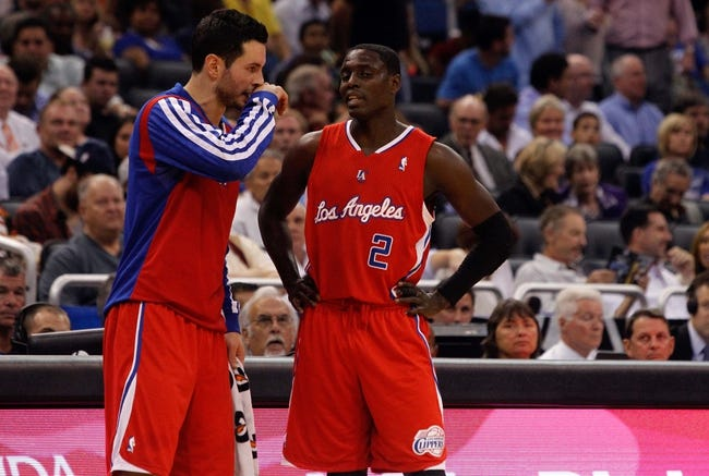 Nov 6, 2013; Orlando, FL, USA; Los Angeles Clippers shooting guard J.J. Redick (4) talks with point guard Darren Collison (2) against the Orlando Magic during the second quarter at Amway Center. Mandatory Credit: Kim Klement-USA TODAY Sports