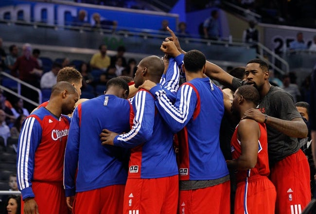 Nov 6, 2013; Orlando, FL, USA; Los Angeles Clippers huddle up against the Orlando Magic during the first quarter at Amway Center. Mandatory Credit: Kim Klement-USA TODAY Sports