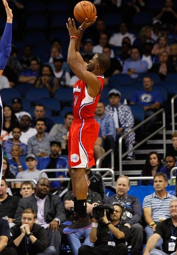 Nov 6, 2013; Orlando, FL, USA;Los Angeles Clippers point guard Chris Paul (3) shoots against the Orlando Magic  during the second half at Amway Center. Orlando Magic defeated the Los Angeles Clippers 98-90. Mandatory Credit: Kim Klement-USA TODAY Sports