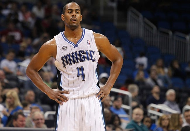Oct 18, 2013; Orlando, FL, USA; Orlando Magic shooting guard Arron Afflalo (4) against the Memphis Grizzlies during the second half at Amway Center. Memphis Grizzlies defeated the Orlando Magic 97-91. Mandatory Credit: Kim Klement-USA TODAY Sports