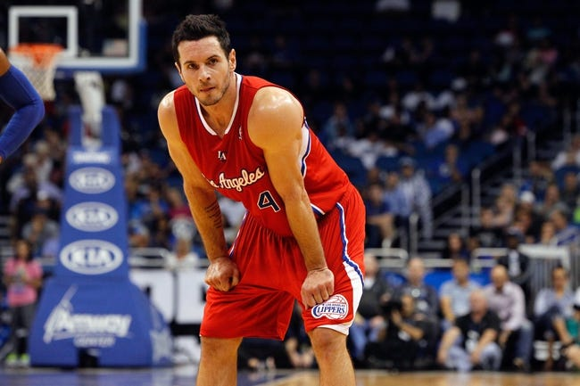 Nov 6, 2013; Orlando, FL, USA; Los Angeles Clippers shooting guard J.J. Redick (4) against the Orlando Magic during the second half at Amway Center. Orlando Magic defeated the Los Angeles Clippers 98-90. Mandatory Credit: Kim Klement-USA TODAY Sports