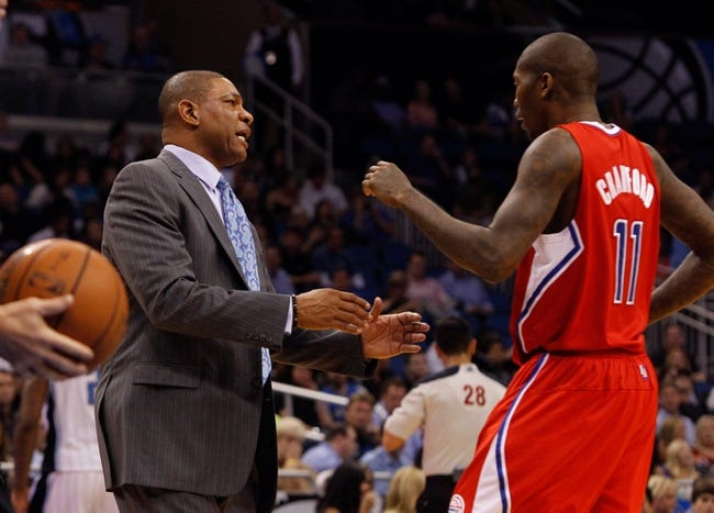 Nov 6, 2013; Orlando, FL, USA; Los Angeles Clippers head coach Doc Rivers talks with shooting guard Jamal Crawford (11) against the Orlando Magic during the second half at Amway Center. Orlando Magic defeated the Los Angeles Clippers 98-90. Mandatory Credit: Kim Klement-USA TODAY Sports
