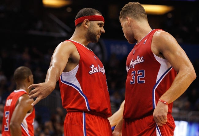 Nov 6, 2013; Orlando, FL, USA; Los Angeles Clippers small forward Jared Dudley (9) talks with power forward Blake Griffin (32) against the Orlando Magic during the second half at Amway Center. Orlando Magic defeated the Los Angeles Clippers 98-90. Mandatory Credit: Kim Klement-USA TODAY Sports