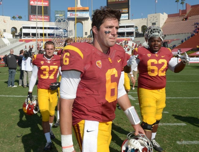 Sep 21, 2013; Los Angeles, CA, USA; Southern California Trojans quarterback Cody Kessler (6) walks off the field after the game against the Utah State Aggies at the Los Angeles Memorial Coliseum. USC defeated Utah State 17-14. Mandatory Credit: Kirby Lee-USA TODAY Sports