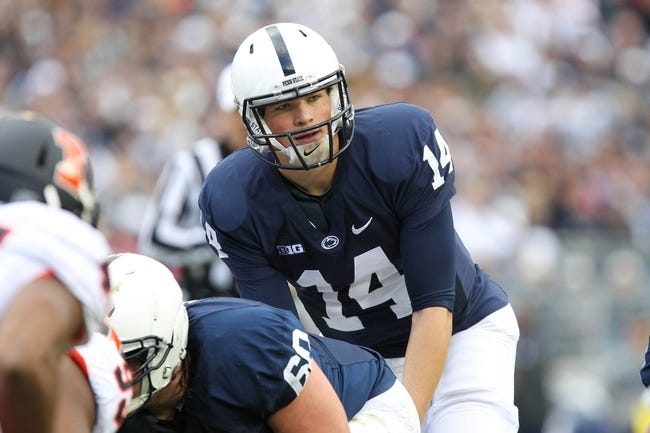Nov 2, 2013; University Park, PA, USA; Penn State Nittany Lions quarterback Christian Hackenberg (14) during the second quarter against the Illinois Fighting Illini at Beaver Stadium. Penn State defeated Illinois 24-17. Mandatory Credit: Matthew O'Haren-USA TODAY Sports
