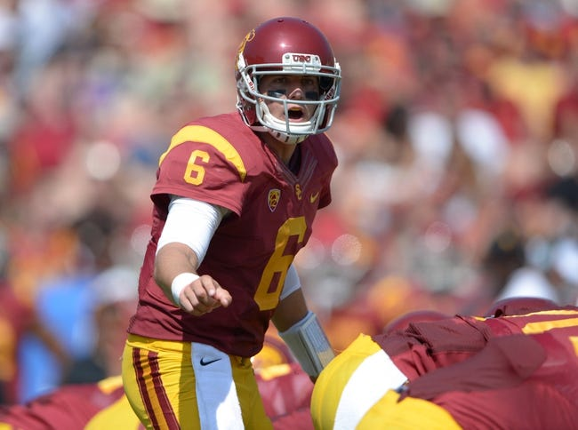 Sep 21, 2013; Los Angeles, CA, USA; Southern California Trojans quarterback Cody Kessler (6) gestures during the game against the Utah State Aggies at the Los Angeles Memorial Coliseum. Mandatory Credit: Kirby Lee-USA TODAY Sports
