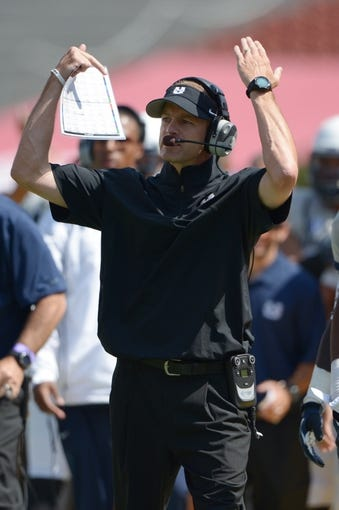 Sep 21, 2013; Los Angeles, CA, USA; Utah State Aggies coach Matt Wells during the game against the Southern California Trojans at the Los Angeles Memorial Coliseum. Mandatory Credit: Kirby Lee-USA TODAY Sports