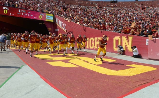 Sep 21, 2013; Los Angeles, CA, USA; Southern California Trojans linebacker Hayes Pullard (10) leads teammates onto the field before the game against the Utah State Aggies at the Los Angeles Memorial Coliseum. Mandatory Credit: Kirby Lee-USA TODAY Sports