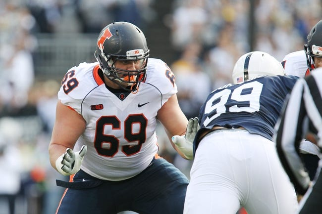 Nov 2, 2013; University Park, PA, USA; Illinois Fighting Illini offensive linesmen Ted Karras (69) blocks during the first quarter against the Penn State Nittany Lions at Beaver Stadium. Penn State defeated Illinois 24-17. Mandatory Credit: Matthew O'Haren-USA TODAY Sports