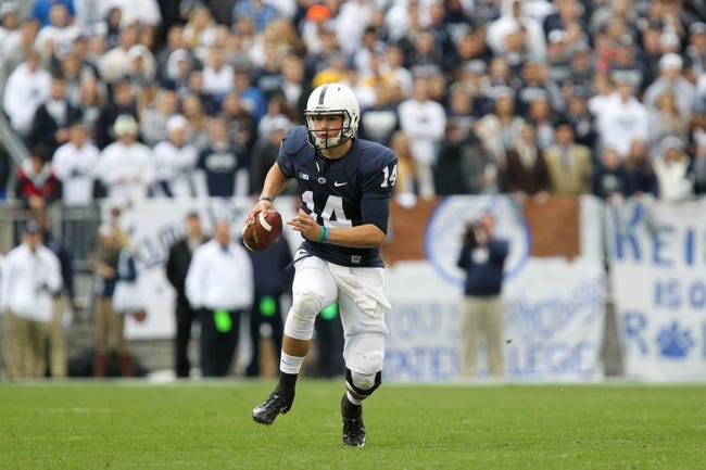 Nov 2, 2013; University Park, PA, USA; Penn State Nittany Lions quarterback Christian Hackenberg (14) runs the ball during the third quarter against the Illinois Fighting Illini at Beaver Stadium. Penn State defeated Illinois 24-17. Mandatory Credit: Matthew O'Haren-USA TODAY Sports