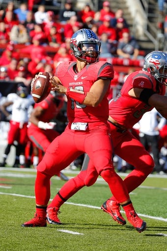 Nov 16, 2013; Piscataway, NJ, USA;  Rutgers Scarlet Knights quarterback Gary Nova (10) throws pass during the first half against the Cincinnati Bearcats at High Points Solutions Stadium. Mandatory Credit: Jim O'Connor-USA TODAY Sports