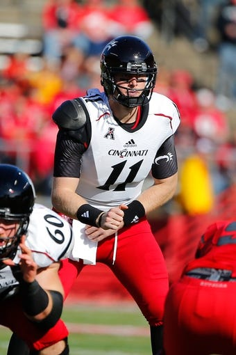 Nov 16, 2013; Piscataway, NJ, USA;  Cincinnati Bearcats quarterback Brendon Kay (11) during the first half against the Rutgers Scarlet Knights at High Points Solutions Stadium. Mandatory Credit: Jim O'Connor-USA TODAY Sports