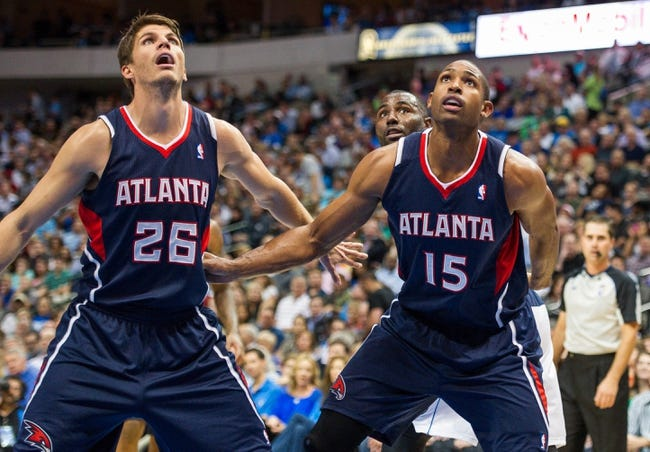 Oct 30, 2013; Dallas, TX, USA; Atlanta Hawks shooting guard Kyle Korver (26) and center Al Horford (15) looks for the ball during the game against the Dallas Mavericks at American Airlines Center. The Mavericks defeated the Hawks 118-109. Mandatory Credit: Jerome Miron-USA TODAY Sports