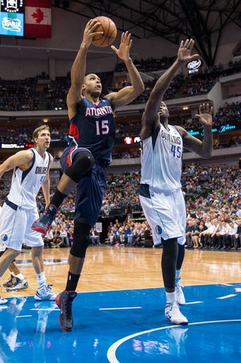 Oct 30, 2013; Dallas, TX, USA; Atlanta Hawks center Al Horford (15) drives to the basket past Dallas Mavericks center DeJuan Blair (45) during the game at American Airlines Center. The Mavericks defeated the Hawks 118-109. Mandatory Credit: Jerome Miron-USA TODAY Sports