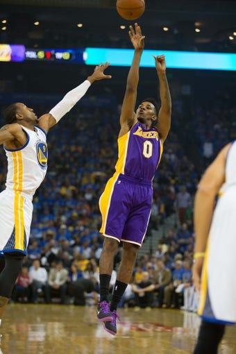 Oct 30, 2013; Oakland, CA, USA; Los Angeles Lakers shooting guard Nick Young (0) shoots the ball against the Golden State Warriors during the first quarter at Oracle Arena. Mandatory Credit: Kelley L Cox-USA TODAY Sports