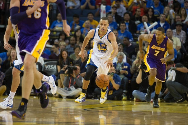 Oct 30, 2013; Oakland, CA, USA; Golden State Warriors point guard Stephen Curry (30) brings the ball down the court against the Los Angeles Lakers during the third quarter at Oracle Arena. The Golden State Warriors defeated the Los Angeles Lakers 125-94. Mandatory Credit: Kelley L Cox-USA TODAY Sports