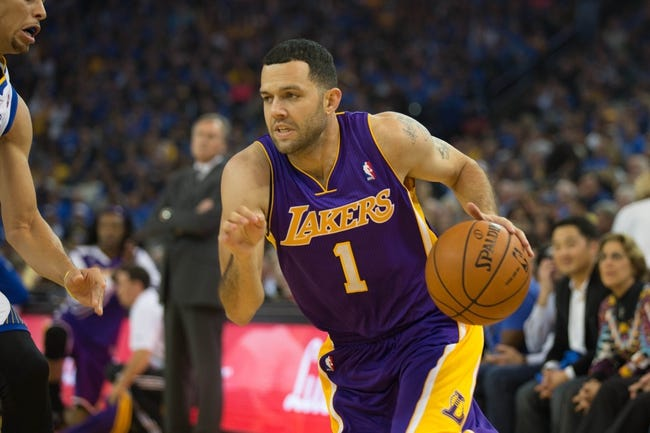 Oct 30, 2013; Oakland, CA, USA; Los Angeles Lakers point guard Jordan Farmar (1) drives in against the Golden State Warriors during the first quarter at Oracle Arena. Mandatory Credit: Kelley L Cox-USA TODAY Sports