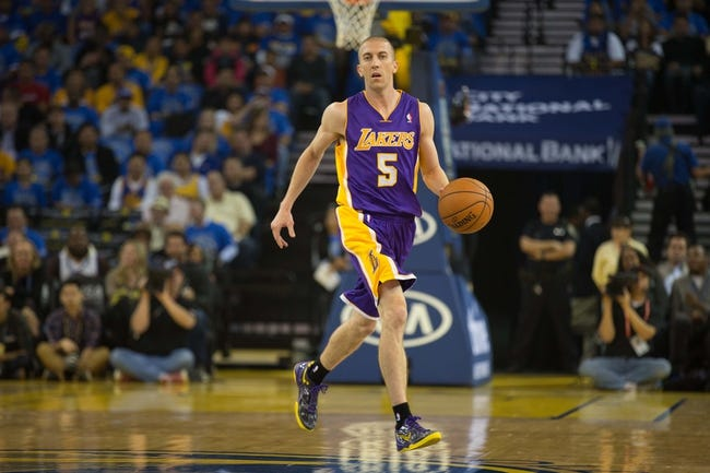 Oct 30, 2013; Oakland, CA, USA; Los Angeles Lakers point guard Steve Blake (5) controls the ball against the Golden State Warriors during the first quarter at Oracle Arena. Mandatory Credit: Kelley L Cox-USA TODAY Sports