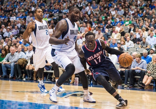 Oct 30, 2013; Dallas, TX, USA; Atlanta Hawks point guard Dennis Schroder (17) drives to the basket past Dallas Mavericks center DeJuan Blair (45) during the game at American Airlines Center. The Mavericks defeated the Hawks 118-109. Mandatory Credit: Jerome Miron-USA TODAY Sports
