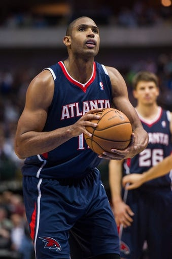 Oct 30, 2013; Dallas, TX, USA; Atlanta Hawks center Al Horford (15) shoots a free throw against the Dallas Mavericks during the game at American Airlines Center. The Mavericks defeated the Hawks 118-109. Mandatory Credit: Jerome Miron-USA TODAY Sports