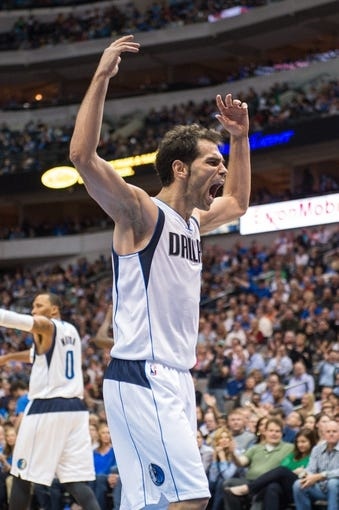Oct 30, 2013; Dallas, TX, USA; Dallas Mavericks point guard Jose Calderon (8) fires up the crowd against the Atlanta Hawks during the game at American Airlines Center. The Mavericks defeated the Hawks 118-109. Mandatory Credit: Jerome Miron-USA TODAY Sports