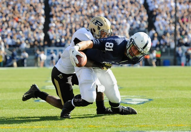Nov 16, 2013; University Park, PA, USA; Penn State Nittany Lions tight end Adam Breneman (81) reaches the ball for the end zone while being tackled by Purdue Boilermakers safety Taylor Richards (4) during the second quarter at Beaver Stadium.  Penn State defeated Purdue  45-21.  Mandatory Credit: Rich Barnes-USA TODAY Sports
