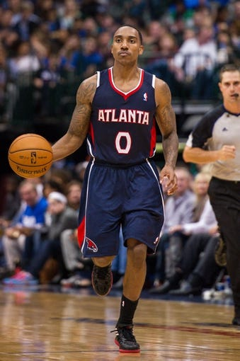 Oct 30, 2013; Dallas, TX, USA; Atlanta Hawks point guard Jeff Teague (0) brings the ball up court against the Dallas Mavericks during the game at American Airlines Center. The Mavericks defeated the Hawks 118-109. Mandatory Credit: Jerome Miron-USA TODAY Sports
