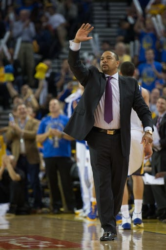 Oct 30, 2013; Oakland, CA, USA; Golden State Warriors head coach Mark Jackson calls out to his players against the Los Angeles Lakers during the third quarter at Oracle Arena. The Golden State Warriors defeated the Los Angeles Lakers 125-94. Mandatory Credit: Kelley L Cox-USA TODAY Sports