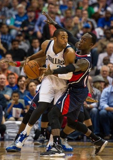 Oct 30, 2013; Dallas, TX, USA; Atlanta Hawks point guard Dennis Schroder (17) guards Dallas Mavericks shooting guard Wayne Ellington (21) during the game at American Airlines Center. The Mavericks defeated the Hawks 118-109. Mandatory Credit: Jerome Miron-USA TODAY Sports