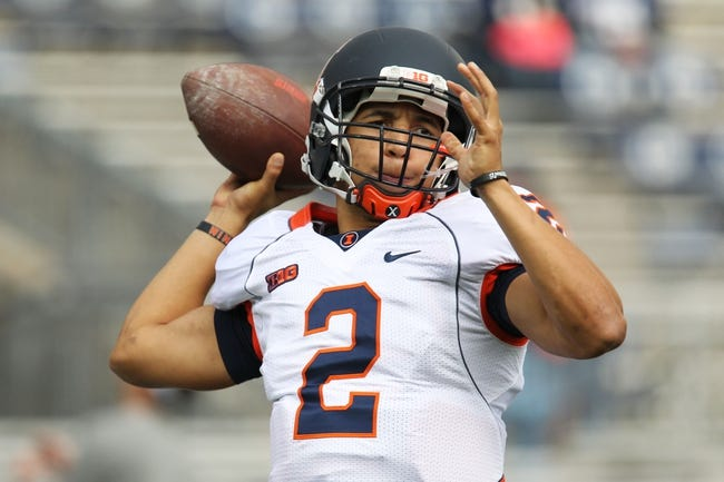 Nov 2, 2013; University Park, PA, USA; Illinois Fighting Illini quarterback Nathan Scheelhaase (2) attempts to throw a pass prior to the game against the Penn State Nittany Lions at Beaver Stadium. Penn State defeated Illinois 24-17. Mandatory Credit: Matthew O'Haren-USA TODAY Sports