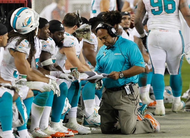 Nov 11, 2013; Tampa, FL, USA; Miami Dolphins linebacker coach George Edwards talks with linebacker against the Tampa Bay Buccaneers during the second half at Raymond James Stadium. Mandatory Credit: Kim Klement-USA TODAY Sports