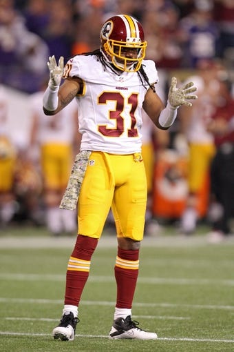 Nov 7, 2013; Minneapolis, MN, USA; Washington Redskins safety Brandon Meriweather (31) against the Minnesota Vikings at Mall of America Field at H.H.H. Metrodome. The Vikings defeated the Redskins 34-27. Mandatory Credit: Brace Hemmelgarn-USA TODAY Sports