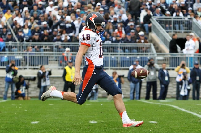 Nov 2, 2013; University Park, PA, USA; Illinois Fighting Illini punter Justin DuVernois (18) attempts to punt the ball during the second quarter against the Penn State Nittany Lions at Beaver Stadium. Penn State defeated Illinois 24-17. Mandatory Credit: Matthew O'Haren-USA TODAY Sports