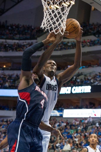 Oct 30, 2013; Dallas, TX, USA; Dallas Mavericks center Samuel Dalembert (1) and Atlanta Hawks power forward Paul Millsap (4) fight for the ball during the game at American Airlines Center. The Mavericks defeated the Hawks 118-109. Mandatory Credit: Jerome Miron-USA TODAY Sports