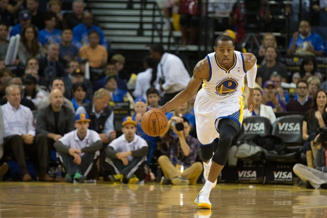 Oct 30, 2013; Oakland, CA, USA; Golden State Warriors shooting guard Andre Iguodala (9) brings down the ball against the Los Angeles Lakers during the third quarter at Oracle Arena. The Golden State Warriors defeated the Los Angeles Lakers 125-94. Mandatory Credit: Kelley L Cox-USA TODAY Sports