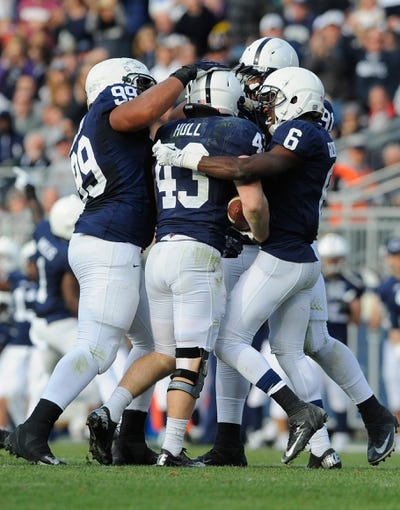 Nov 16, 2013; University Park, PA, USA; Penn State Nittany Lions linebacker Mike Hull (43) is congratulated by teammates after recovering a fumble against the Purdue Boilermakers during the fourth quarter at Beaver Stadium.  Penn State defeated Purdue  45-21.  Mandatory Credit: Rich Barnes-USA TODAY Sports