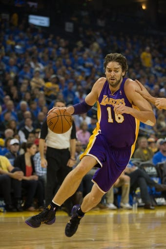Oct 30, 2013; Oakland, CA, USA; Los Angeles Lakers power forward Pau Gasol (16) drives in against the Golden State Warriors during the first quarter at Oracle Arena. Mandatory Credit: Kelley L Cox-USA TODAY Sports