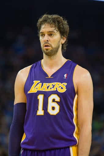 Oct 30, 2013; Oakland, CA, USA; Los Angeles Lakers power forward Pau Gasol (16) between plays against the Golden State Warriors during the second quarter at Oracle Arena. Mandatory Credit: Kelley L Cox-USA TODAY Sports