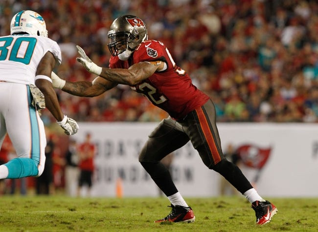Nov 11, 2013; Tampa, FL, USA; Tampa Bay Buccaneers outside linebacker Jonathan Casillas (52) rushes against the Miami Dolphins during the second half at Raymond James Stadium. Mandatory Credit: Kim Klement-USA TODAY Sports