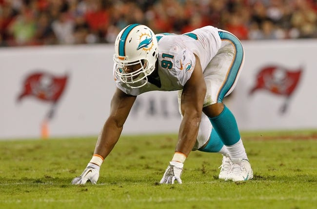 Nov 11, 2013; Tampa, FL, USA; Miami Dolphins defensive end Cameron Wake (91) rushes against the Tampa Bay Buccaneers during the second half at Raymond James Stadium. Mandatory Credit: Kim Klement-USA TODAY Sports