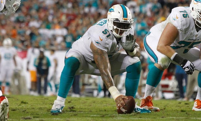 Nov 11, 2013; Tampa, FL, USA; Miami Dolphins center Mike Pouncey (51) gets ready to hike the ball against the Tampa Bay Lightning during the first half at Raymond James Stadium. Mandatory Credit: Kim Klement-USA TODAY Sports