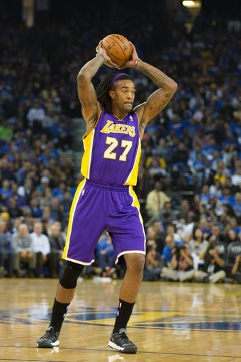 Oct 30, 2013; Oakland, CA, USA; Los Angeles Lakers center Jordan Hill (27) controls the ball against the Golden State Warriors during the second quarter at Oracle Arena. Mandatory Credit: Kelley L Cox-USA TODAY Sports