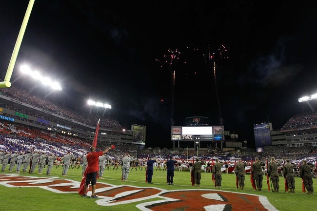 Nov 11, 2013; Tampa, FL, USA; Military members stand on the field during the national anthem prior to the game between the Tampa Bay Buccaneers and Miami Dolphins at Raymond James Stadium. Mandatory Credit: Kim Klement-USA TODAY Sports