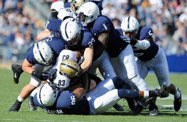 Nov 16, 2013; University Park, PA, USA;   A group of Penn State Nittany Lions defenders tackle Purdue Boilermakers wide receiver B.J. Knauf (83) during the first quarter at Beaver Stadium.  Penn State defeated Purdue  45-21.  Mandatory Credit: Rich Barnes-USA TODAY Sports