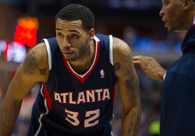Oct 30, 2013; Dallas, TX, USA; Atlanta Hawks power forward Mike Scott (32) during the game against the Dallas Mavericks at American Airlines Center. The Mavericks defeated the Hawks 118-109. Mandatory Credit: Jerome Miron-USA TODAY Sports