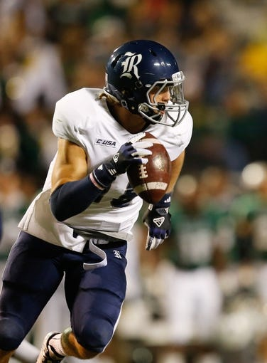 Nov 21, 2013; Birmingham, AL, USA;  Rice Owls quarterback Taylor McHargue (16) scrambles with the ball against the UAB Blazers at Legion Field. Mandatory Credit: Marvin Gentry-USA TODAY Sports
