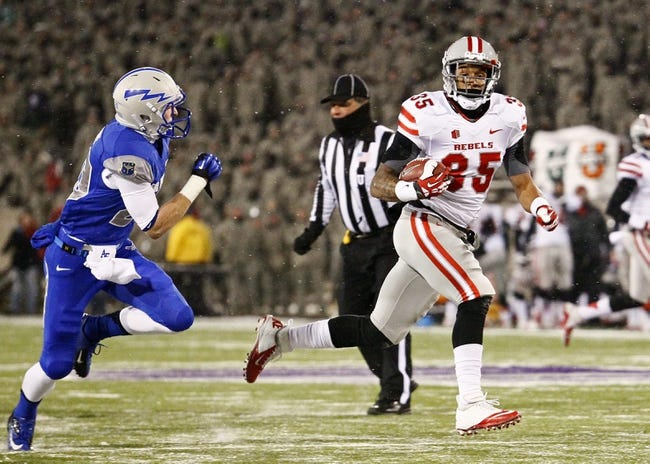 Nov 21, 2013; Colorado Springs, CO, USA; UNLV Rebels running back Tim Cornett (35) runs for a touchdown ahead of Air Force Falcons defensive back Gavin McHenry (20) in the first quarter at Falcon Stadium. Mandatory Credit: Isaiah J. Downing-USA TODAY Sports