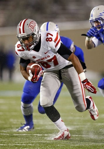 Nov 21, 2013; Colorado Springs, CO, USA; UNLV Rebels wide receiver Maika Mataele (87) runs the ball in the first quarter against the Air Force Falcons at Falcon Stadium. Mandatory Credit: Isaiah J. Downing-USA TODAY Sports