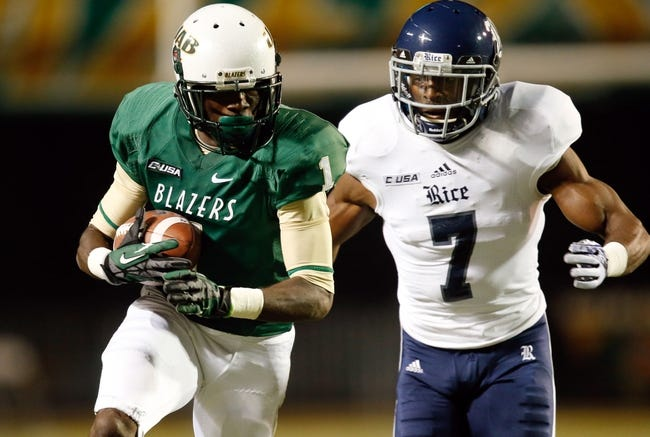 Nov 21, 2013; Birmingham, AL, USA; UAB Blazers wide receiver Jamarcus Nelson (1) catches the ball as Rice Owls safety Julius White (7) defends at Legion Field. The Owls defeated the Blazers 37-34 in overtime. Mandatory Credit: Marvin Gentry-USA TODAY Sports